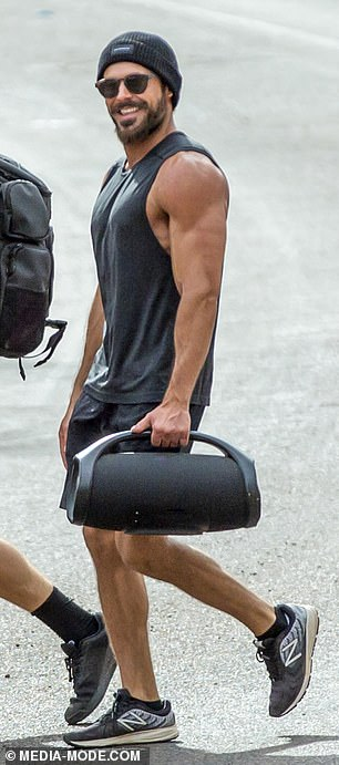 Sizzling: Zac looked nothing short of sensational as he waltzed down the street in his gym ensemble, which consisted of the singlet and a pair of thigh-grazing shorts