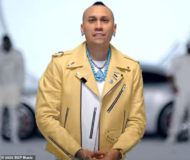 Here it is: Taboo of the Black Eyed Peas, whose name is Jaime Luis Gomez, was in an eye-catching ensemble that included turquoise jewelry and a yellow leather jacket