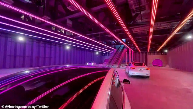 The Boring Companyshared a first look inside with three Tesla vehicles parked at the boarding area, along with flashing lights and dance music by the late musician Avici playing in the background