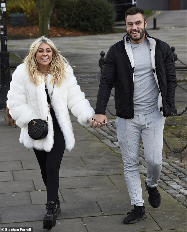Still going strong: Paige Turley, 21, and Finley Tapp, 23, looked as loved-up as ever recently, when they were spotted enjoying a morning stroll in Manchester
