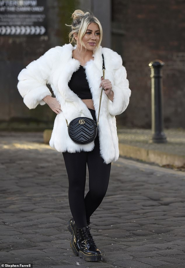 Stepping out in style: Paige stepped out in style for the leisurely excursion, donning a black crop top and matching leggings under a white fluffy coat
