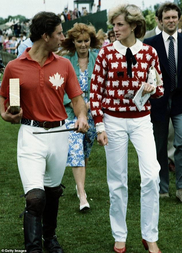 Statement:It was apparently a gift from the mother of one of the princess' page boys at her wedding to Prince Charles in 1981, many believed the jumper cheekily hinted at her feelings of being an outsider in the Royal family (Princess Diana and Prince Charles pictured in1983)