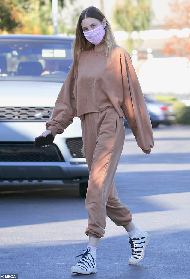 Whitney Port keeps it comfy and casual in a brown tracksuit while picking up coffee in LA