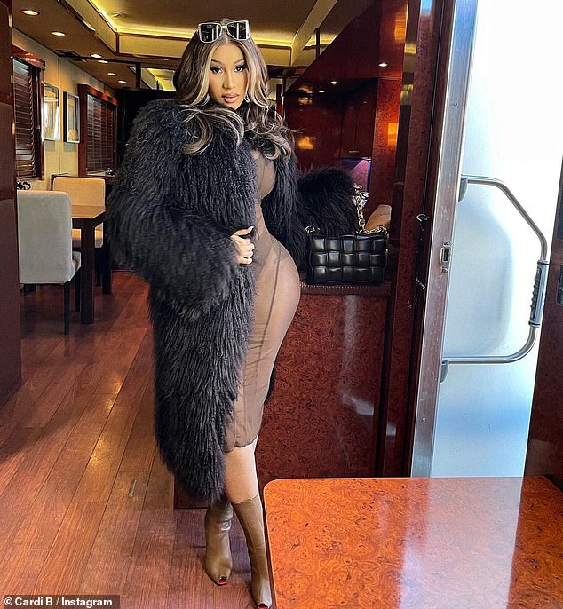 Famous Curves: While the 28-year-old Grammy-winning performer initially sported a nearly floor-length black coat, she eventually slipped the furry garment off to flash her glowing booty.