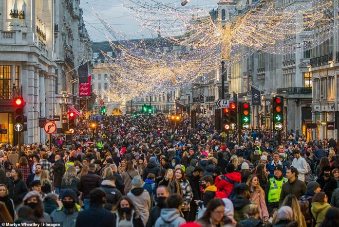 London's Regent Street was overrun with shoppers at the start of what is expected to be a £ 1.5bn spending spree on Saturday