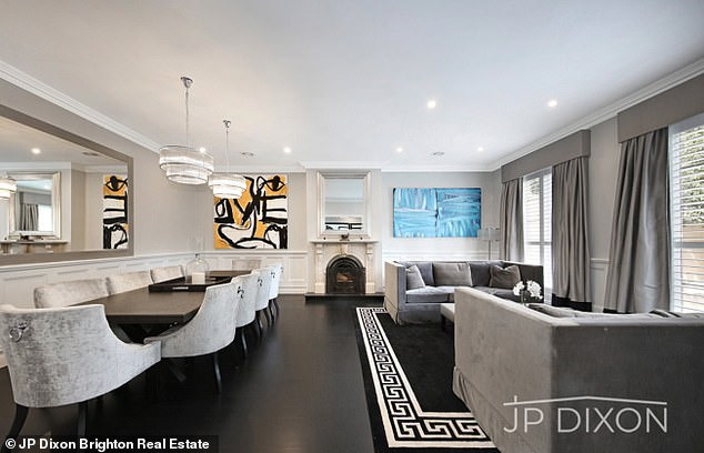 On trend: The home has sweeping spaces and a black and white theme throughout