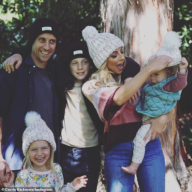 Family: Carrie has three children, Evie, five, and Adelaide, two, with partner Chris Walker, and son Oliver, 13, with late husband Greg Lange, who died of brain cancer in 2010