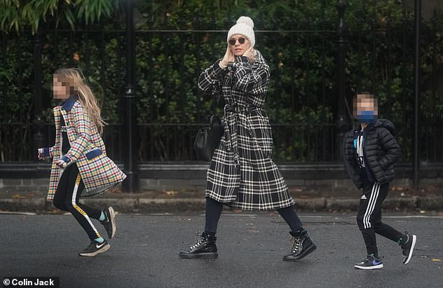 In good company: Holly Willoughby shopped in west London with her daughter Belle, nine, and son Chester, six, on Sunday, following her kids' coronavirus scare