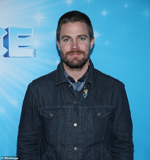 Sidelined: Stephen Amell, 39, suffered a back injury in late October while performing a stunt on the set of his new Starz wrestling series Heels