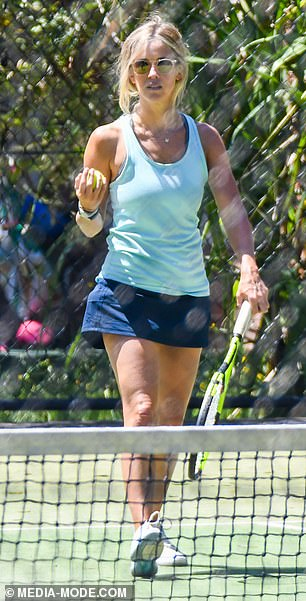 Stunning: The pretty blonde showed off her bronzed physique in her tennis outfit