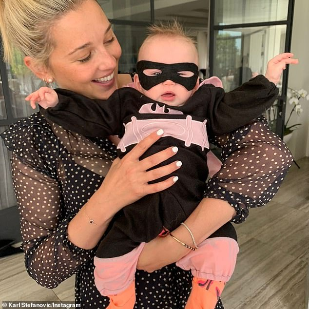 'What joy you bring to us all': Karl Stefanovic, 46, shared an emotional tribute to his wife Jasmine Yarbrough, 36, (pictured with daughter Harper May, seven months) as they celebrated their second wedding anniversary on Tuesday