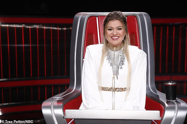 Angelic outfit: The American Idol winner looked angelic in a long-sleeved white dress