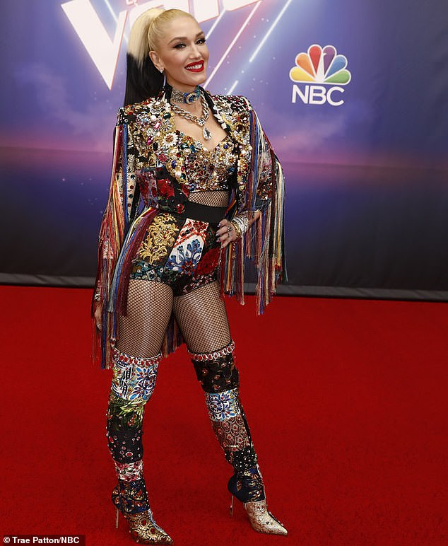 Pop star: Gwen got dressed up for her performance with two-tone hair and a fishnet outfit