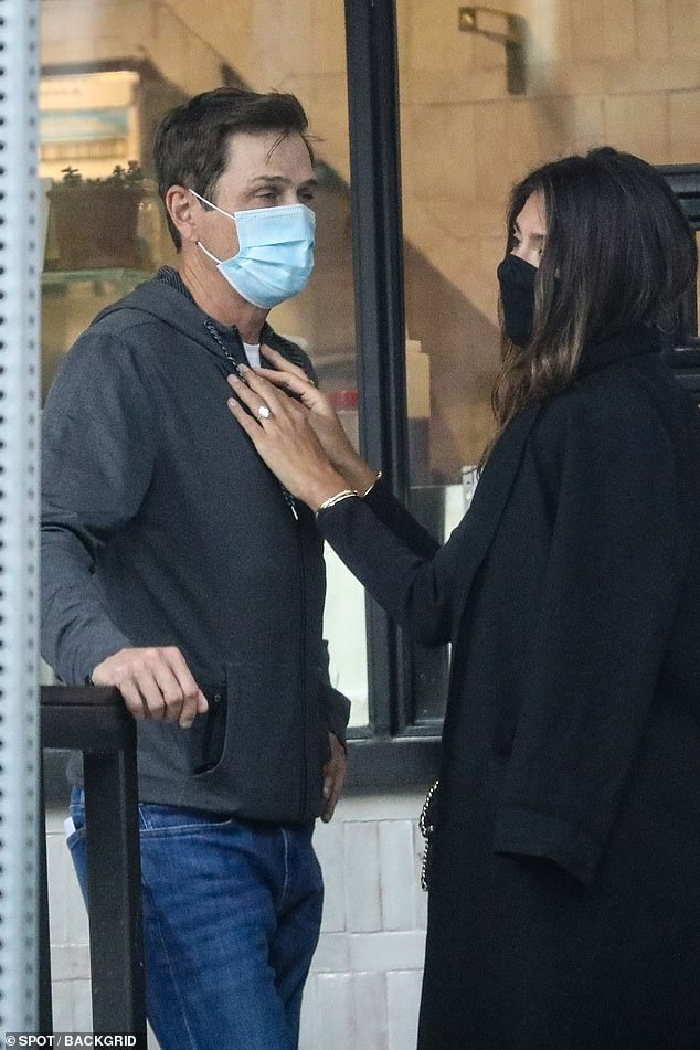Flaunting it: Resting her hands against the 55-year-old Hollywood agent's chest, Pia showed off her engagement ring, which is rumoured to be worth a whopping $1.9million