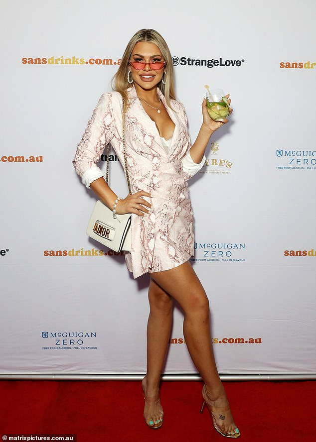 Strike a pose! Kiki paired her flirty dress with pink-tinted sunglasses and transparent heels
