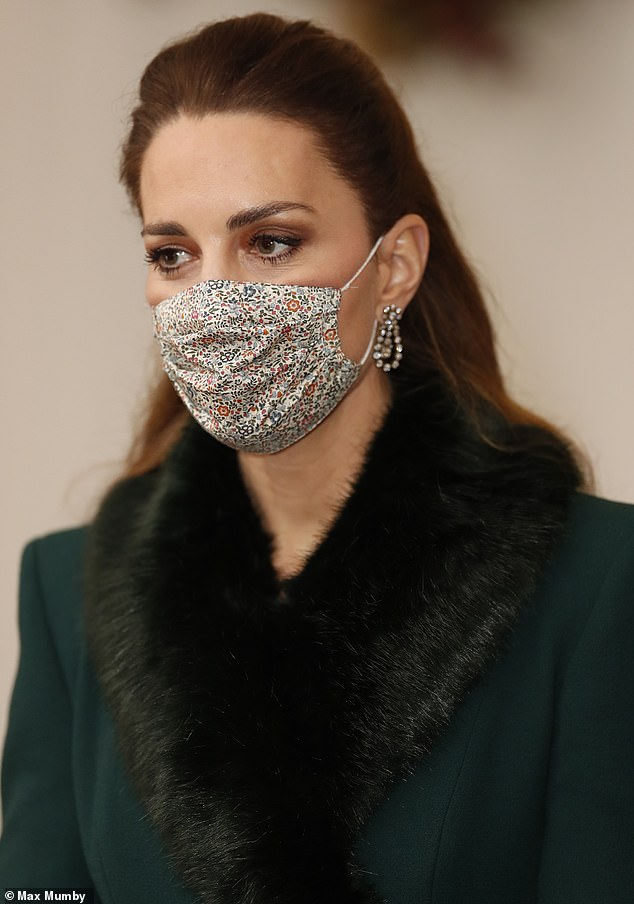 Favourite florals: The Duchess of Cambridge wore a £15 face mask from Amaia Kids for last night's engagement. It was made with the Katie & Millie fabric from Liberty