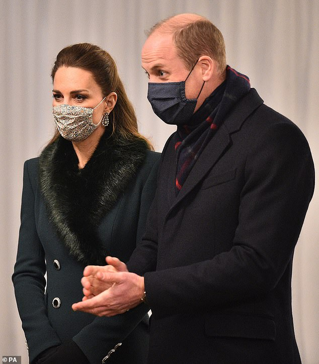 Nice and neutral:Unlike his fashionable wife, Prince William has taken a practical approach when it comes to his face coverings. The reusable fabric face mask he wore last night was made from a cotton navy fabric with a subtle polka dot pattern. The designer is unknown