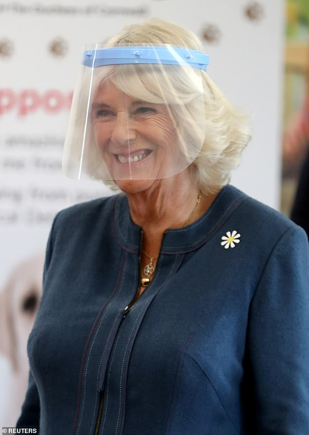 Brief experiment: The Duchess of Cornwall was also the first member of the royal family to wear a face shield (pictured on a visit to a medical dog training centre in September)