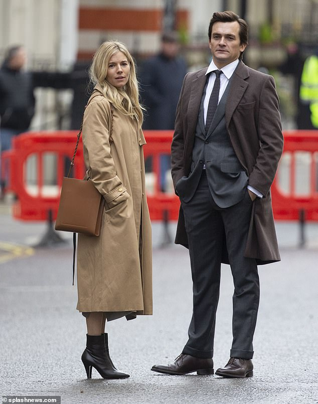 Here she is!Sienna Miller, 38, was seen on-set for the first time filming Netflix's political drama Anatomy Of A Scandal with Rupert Friend on Sunday