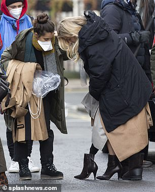 Preparing: The crew assisted Sienna in getting ready to film the scene