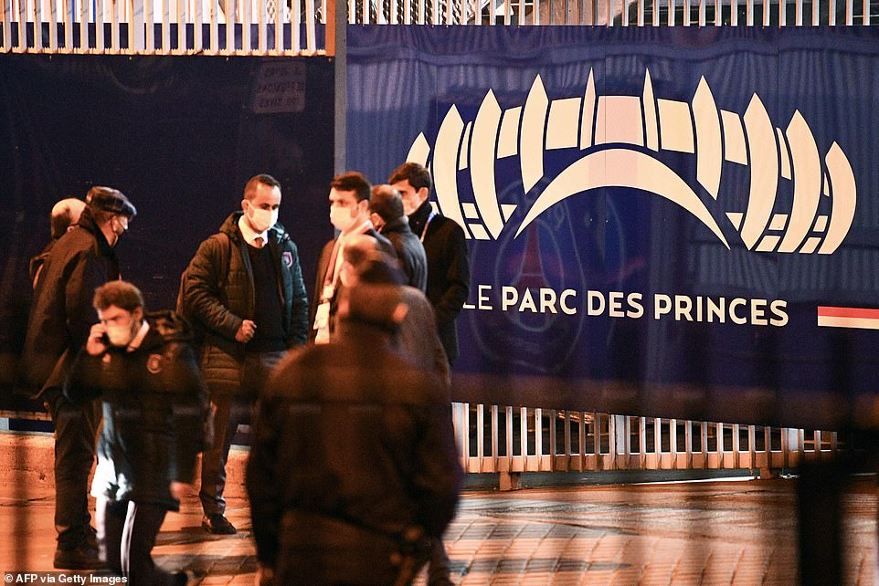 Members of the Basaksehir staff make their way out of Parc des Princes after the incident