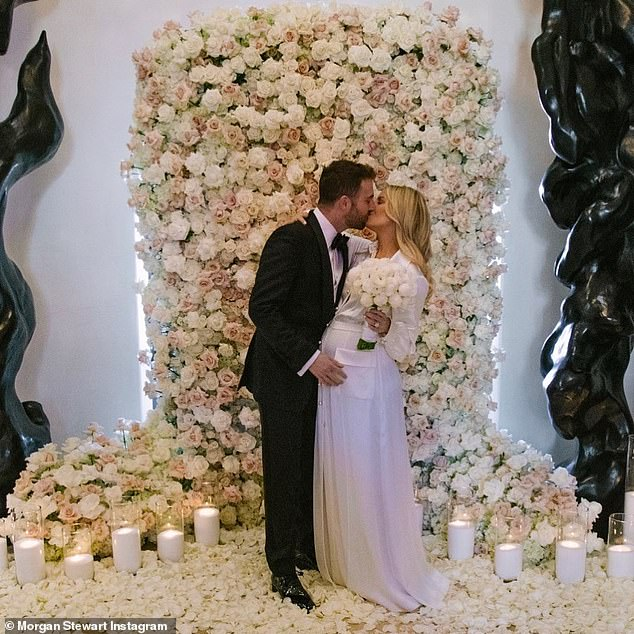 Jordan McGraw and Morgan Stewart tie the knot in an intimate ceremony in  front of a wall of roses | Daily Mail Online