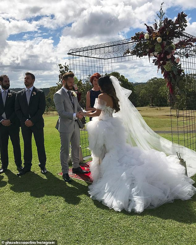 Happily wed: They were married in February 2018. Pictured on their wedding day