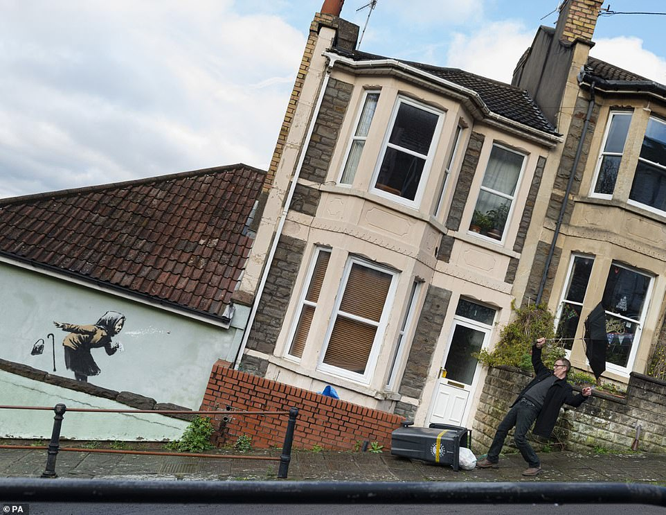 Family insist they WILL sell £340,000 house decorated with Banksy's 'Aachoo!' mural