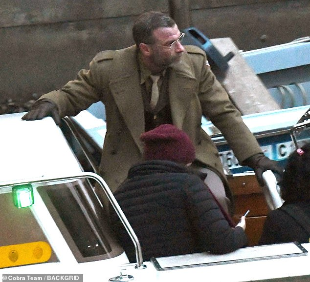 Military character:The X Men star, 53, cut a dapper figure in a khaki green suit, waistcoat and tie, teamed with a co-ordinated military style overcoat and leather gloves