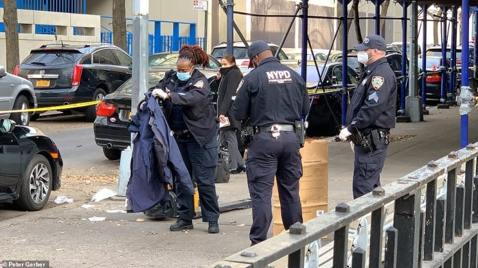 NYPD officer picks up jacket from street following Friday incident in the heart of the Big Apple