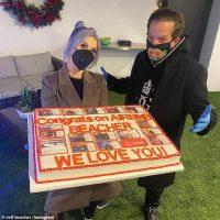 Kelly Osbourne presents showman BFF Jeff Beacher with a cake to celebrate Airbnb IPO