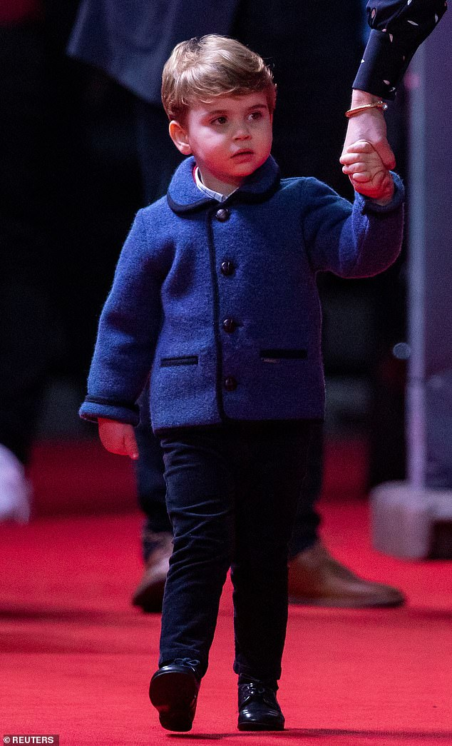 Little Louis looked adorable as he arrived holding the hand of his mother, Duchess of Cambridge, to London Palladium in the West End to watch Pantoland, Friday evening