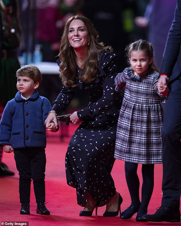 Catherine, Duchess of Cambridge, Prince Louis and Princess Charlotte attend a special pantomime performance at London's Palladium Theatre, hosted by The National Lottery