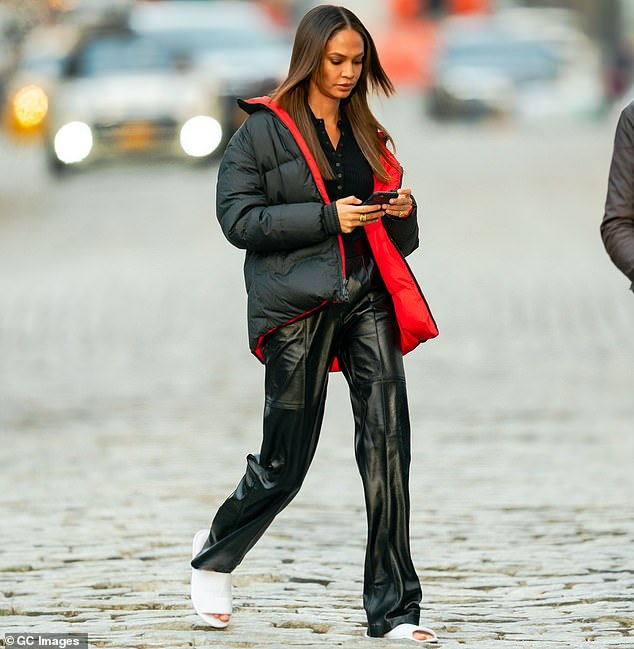 Mover and shaker:Bundling up against the wintertime chill in a cozy-looking anorak, she navigated the cobblestones on a pair of open-toe slippers