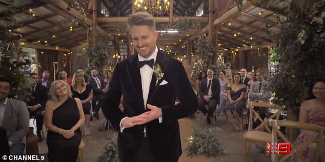 Cheers!Three more grooms likewise appear in the promo, one who is smiling happily in a velvet tux