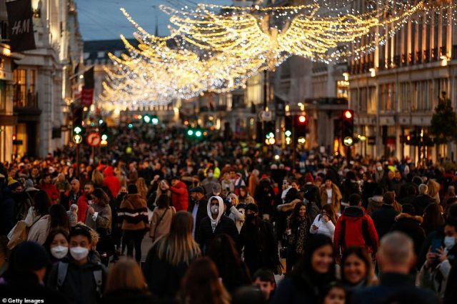 Britain's high streets (Regent Street, pictured yesterday) have been packed with eager Christmas shoppers as the country's case-total soars by 21,502 - a 38 per cent rise on last Saturday's figure