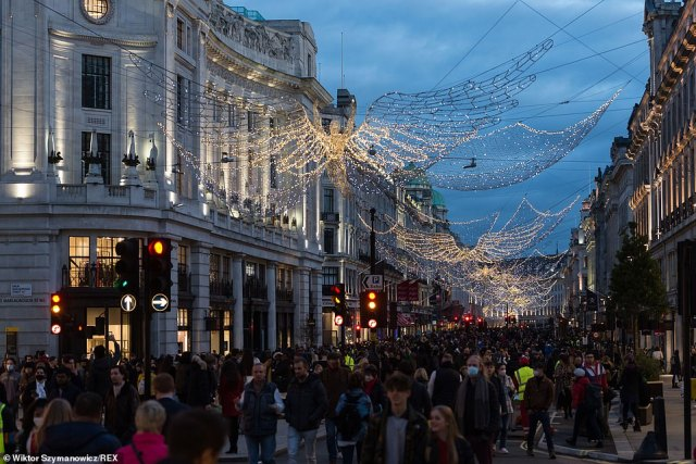 Families across the UK can form a Christmas 'bubble' and spend the festive season with no more than three households between December 23 and 27. Pictured: Shoppers out in Regent Street on Saturday