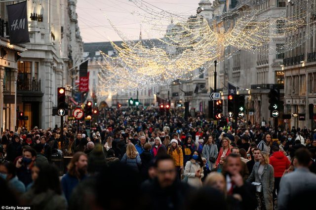Christmas shoppers walk along Regent Street on December 12. Crowds descended on non-essential stores in the run-up to Christmas