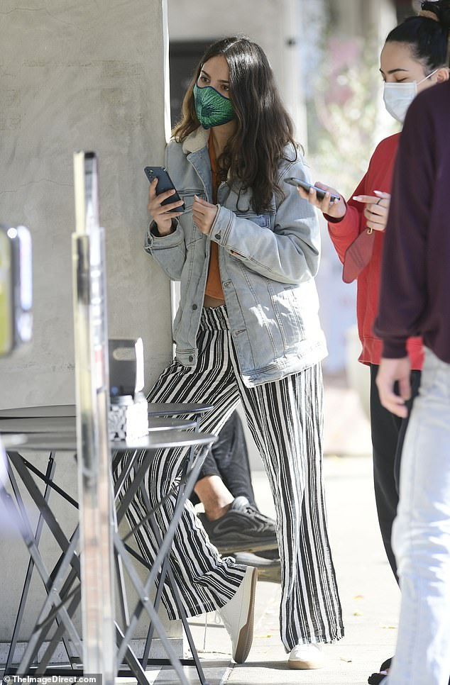 Safety first:The Baby Driver actress, 30, helped deter the spread of COVID-19 by rocking a cloth face mask for the duration of her outing