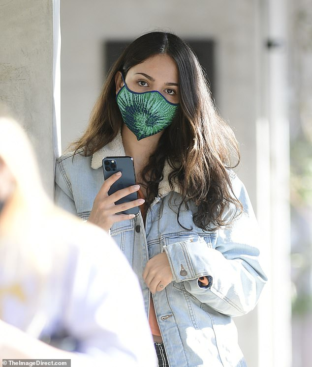 Eiza Gonzalez keeps cozy in a fleece-lined denim jacket as she heads out on a solo coffee run