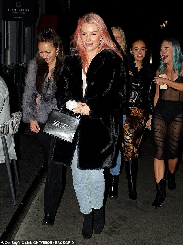 Pals: Lottie Moss (front) was spotted dining with pals at London's Xier restaurant on Saturday