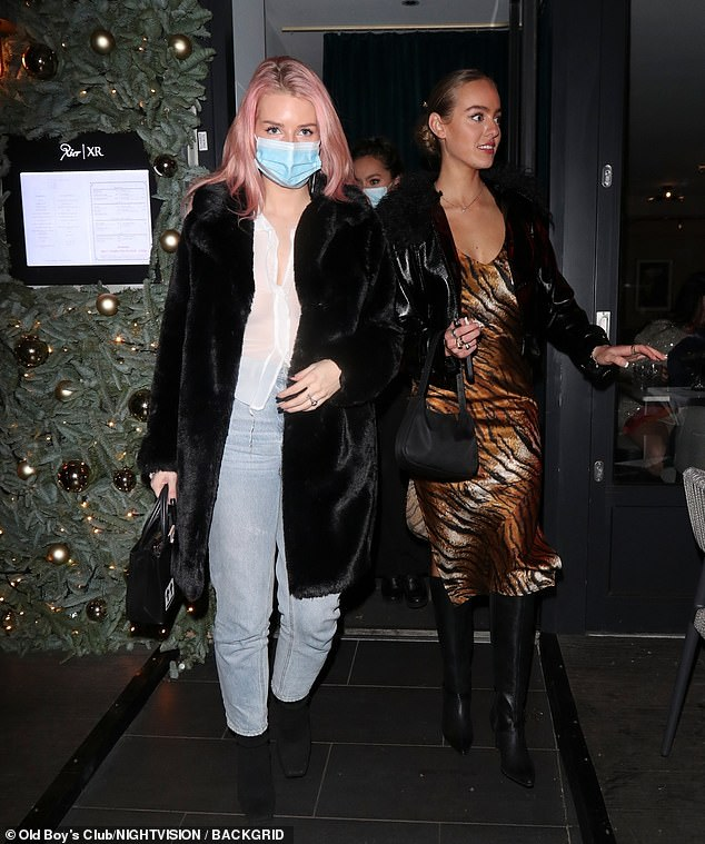 Safety first: Lottie, 22, was seen wear a face mask as she made her arrival at the upscale eatery