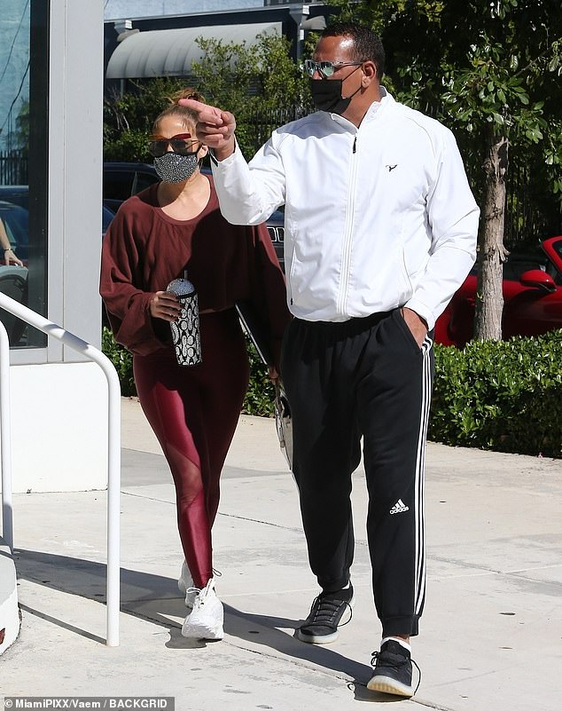 Flowing: Jennifer covered in a fluid burgundy sweatshirt with loose sleeves