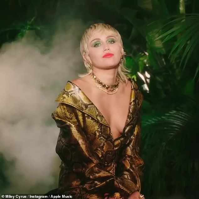 Making light: Miley Cyrus cheekily celebrated the ten-year anniversary of her getting caught doing a bong hit, just five days after her 18th birthday, in a video obtained by TMZ