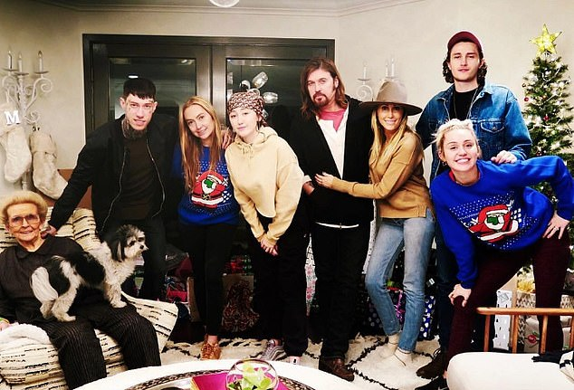 A very Cyrus Christmas! 'You're sitting round the table full of artists that are very opinionated and we love to bring up all conspiracy theories at the dinner table that usually ends in some sort of debate and everyone being upset,' Miley said. Pictured: Miley and family