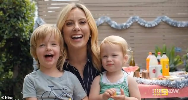 Sweet: Meanwhile, Allison and her children - son Mack, three, daughter Scout, two - excitedly wish viewers a Merry Christmas