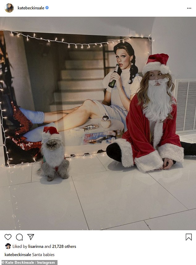 Kate Beckinsale and beloved 'grumpy' cat Clive dress up as Santa for annual festive Instagram snap