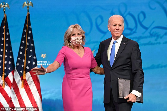Jill Biden, pictured on Monday night with her husband, was attacked by Tucker Carlson