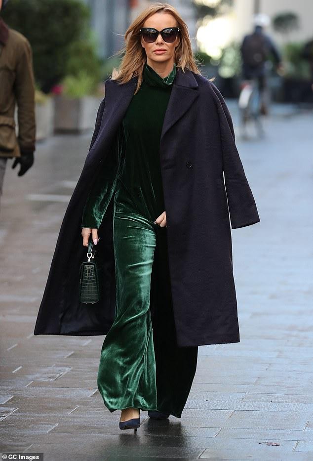 Amanda Holden embraces the festive spirit in an emerald green velvet co-ord