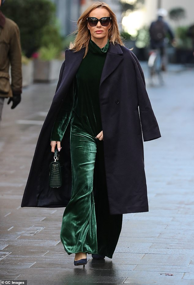 Amanda Holden embraces the festive spirit in an emerald green velvet co-ord